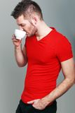 Sporty guy drinking coffee Royalty Free Stock Photography