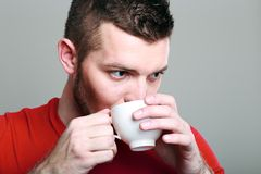 Sporty guy drinking coffee Stock Photo