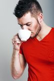 Sporty guy drinking coffee Stock Image