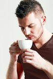 Sporty guy drinking coffee Royalty Free Stock Photos