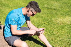 Sporty guy listening to music while training Stock Photo
