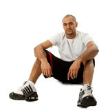 Sporty guy sitting Stock Photo