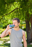 Sporty handsome man in the park Royalty Free Stock Photo