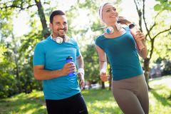 Sporty happy couple exercising together. Sport concept royalty free stock image