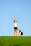 Sporty happy woman running with dog Royalty Free Stock Image