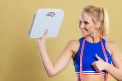 Sporty happy woman with scale, weight loss Stock Photography