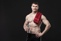 Sporty and healthy man  on black background Royalty Free Stock Photo