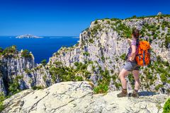 Sporty hiker woman enjoys her natural cliffs, sea and nature stock image