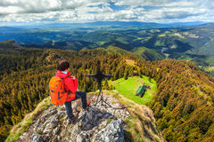Sporty hiker woman on the top of mountain, Transylvania, Romania Stock Images