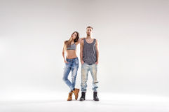 Sporty hip-hop couple isolated over the white background Stock Photography