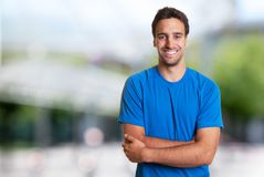 Sporty hispanic man with beard looking at camera. Outdoor in the summer Royalty Free Stock Images