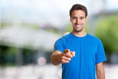 Sporty hispanic man with beard pointing at camera. Outdoor in the summer Royalty Free Stock Photo