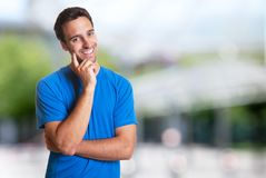 Sporty hispanic man with beard smiling at camera. Outdoor in the summer Stock Photography