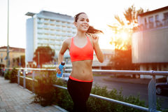 Sporty jogger going for a run. In urban city area Royalty Free Stock Photo