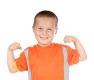 Sporty kid flexing stock image