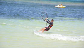 Sporty kitesurfer impressing the girls Royalty Free Stock Photos