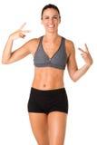 Sporty kobieta Robi zwycięstwo znakowi Fotografia Stock