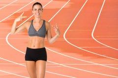 Sporty kobieta Robi zwycięstwo znakowi Obrazy Stock