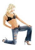 Sporty lady in blue jeans Royalty Free Stock Photography