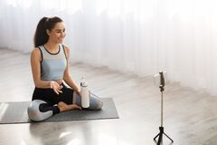 Free Sporty Lady Yoga Teacher Shooting Video From Home Stock Images - 214612484