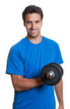 Sporty latin guy with dumbbell Royalty Free Stock Image