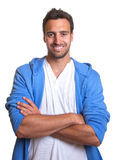 Sporty latin man with crossed arms Royalty Free Stock Image