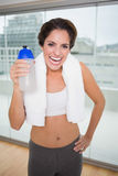 Sporty laughing brunette holding water bottle Stock Image