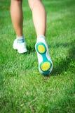 Sporty legs in sneakers Stock Photo