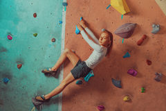 Sporty little girl climbing indoor Royalty Free Stock Photo