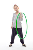 Sporty llittle girl with hula hoop Stock Photos