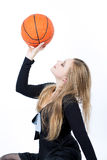 Sporty looking blond girl with backetball ball Royalty Free Stock Photos