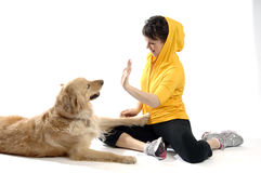 Sporty looking woman with her dog Royalty Free Stock Images