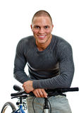 Sporty male with bicycle. Royalty Free Stock Photo