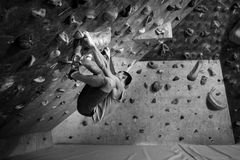 Sporty male training indoor. Sports and fitness concept. Active man with fit muscular body doing gym climbing exercises Stock Photos
