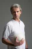 Sporty man with a ball Stock Images
