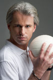 Sporty man and a ball Royalty Free Stock Image