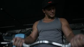 Sporty man is doing biceps curl stock video