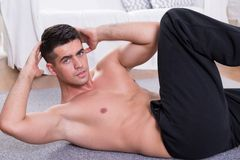 Sporty man doing oblique crunches Stock Image