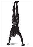 Sporty man doing street workout exercise. Handstand Stock Photography