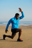 Sporty man doing walking lunges exercise before running Stock Image