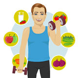 Sporty man with dumbbells and variety of healthy fruits Stock Photos