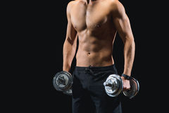 Sporty man exercising with weights Stock Images