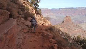 Sporty Man Hiking On A Footpath Trail In Grand Canyon National Park
