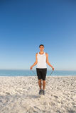 Sporty man jumping rope Stock Photo