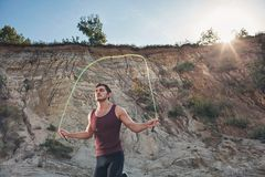 Sporty man jumping rope outdoors Royalty Free Stock Photos