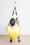 Sporty man makes suspension training Stock Image