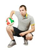 Sporty man posing with ball Stock Images