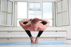 Sporty man practicing yoga. Squat, Garland pose, Malasana. Sporty man practicing yoga. Sitting in squat, Garland pose, Malasana Royalty Free Stock Photo