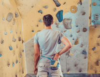 Sporty man preparing to climb Royalty Free Stock Image