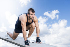 Sporty man preparing to run through the sky. Stock Photos